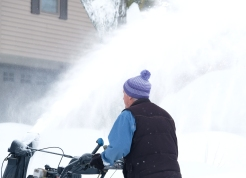 Paul Haack blows the snow off his driveway in Baronage. Wed snow pix
