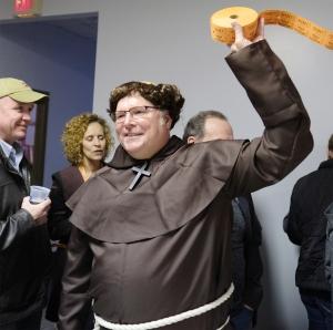Fish Friar Mike Conrad sells split the pot tickets.