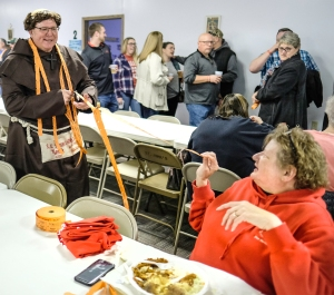 Fish Friar Mike Conrad and Sue Hershman split tickets for the split the pot drawing.