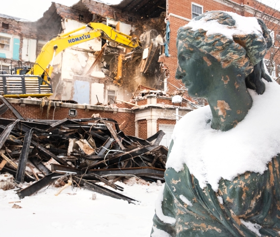 Statue faces building being demolished