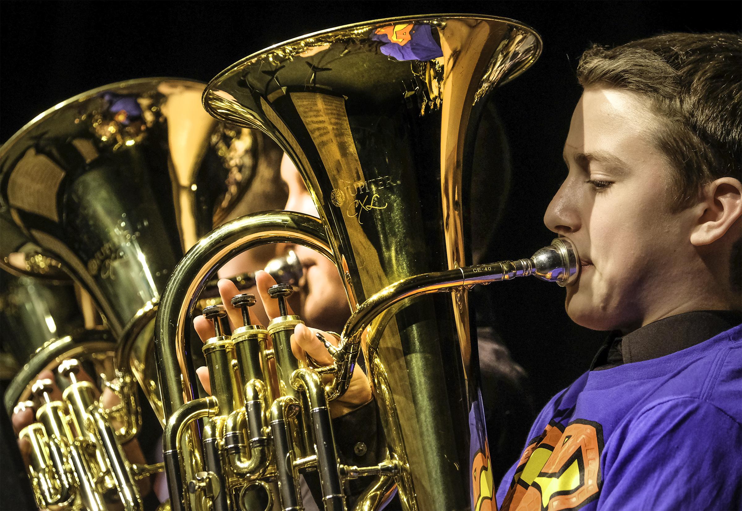 Boys play baritone horns
