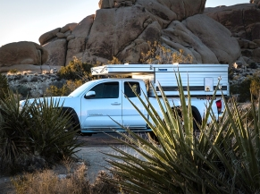 Tacoma pickup and camper at a camping spot at Joshua Tree National Park