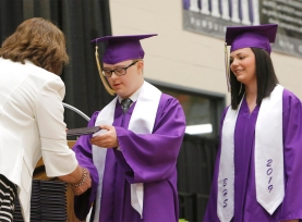Hannah Bacon waits as Blair School Board president Kari Loseke presents Alec Aman with his diploma