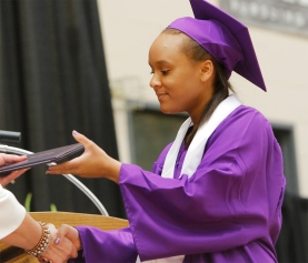 Ambrosia Alston is first in liner to receive her diploma.
