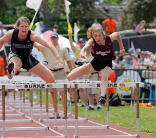 Arlington's Kailynn Gubbels runs the 100-meter hurdles at Omaha Burke Stadium