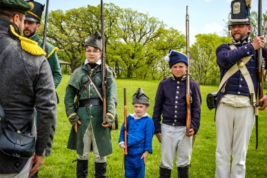 Sergeant of the Guard Stephen Baker inspects rifle brigade members from left Andrew Gahagen, Liam Baker, Isac Baker, Caleb Baker and Ben Godfrey. Fort Atkinson Living History.