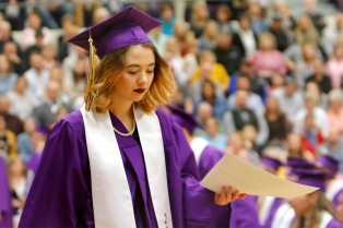 Kennedy Bolton walks across the platform after receiving her scholarship certificates.
