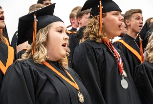 Molly Penas, Riley Mitchell and the Concert Choir perform one last song together at Fort Calhoun graduation.