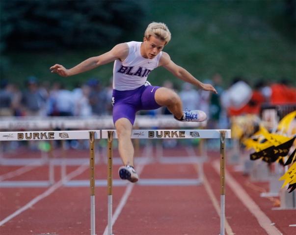Blair senior Ethan Rowe runs the 300-meter hurdles at Omaha Burke Stadium