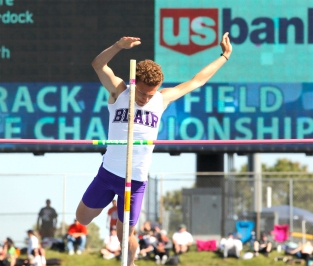 Blair senior Evan Slominski competes in the pole vault at Omaha Burke Stadium