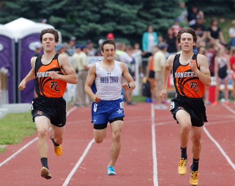 Fort Calhoun's Jacob, left, and Ben Haggar, right run the 400-meter dash at Omaha Burke Stadium
