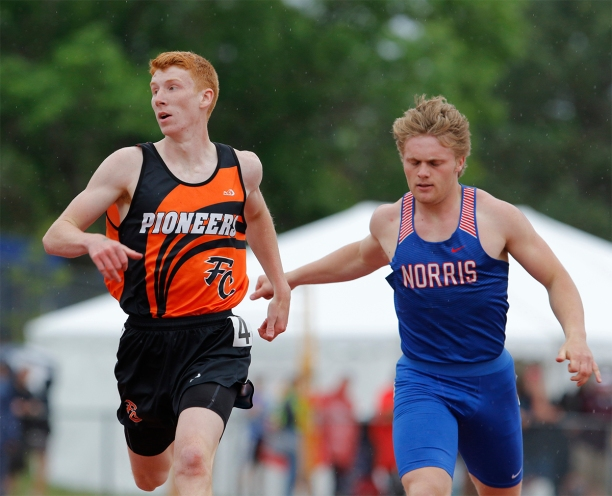 Fort Calhoun senior Zack Marshall, left, races Norris' Ashton Hausmann to the finish line of t