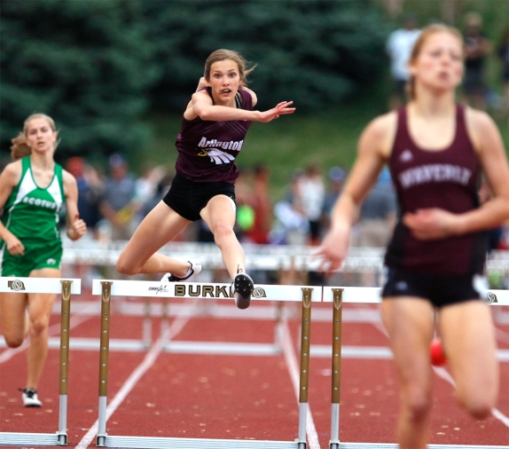 Arlington freshman Kailynn Gubbels, middle, runs the 300-meter hurdle prelims at Omaha Burke Stadium