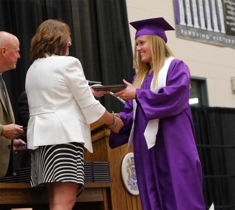 Jaycie Meggison receives her diploma from School board President Keri Loseke.