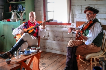 From left, Doug Kuony portraying Indian sub-agent John Doughert and Dave Blakeslee portraying an itinerate musician perform tunes appropriate to he 1820 time period.