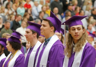 Seniors stand during the commencement procession.
