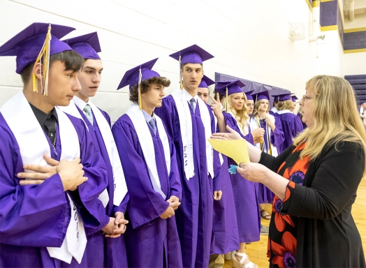Karla Gregory checks to make sure the seniors are lined up in the correct order before commencement exercises begin.