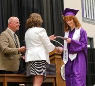 Susie Koch receives her diploma from School board President Keri Loseke.