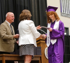 Susie Koch receives her diploma from School board President Keri Loseke.