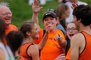 Taya Skelton of fort Calhoun celebrates her state title win in the 3,200-meter run Friday at Omaha Burke Stadium