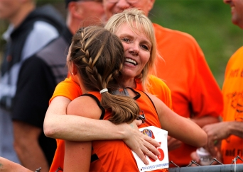 Fort Calhoun's Taya Skelton gets a hug from her mother, Cindy, at Omaha Burke Stadium