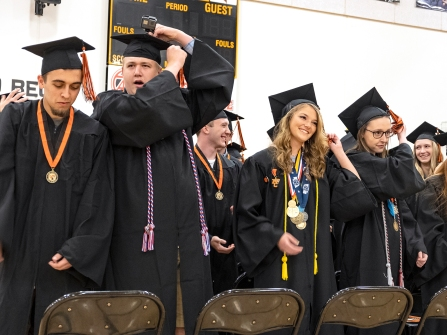 Turning tassels Caleb Steiner, Nicholas Smith, Taya Skelton, and Megan Rupp and classmates turn their tassels.