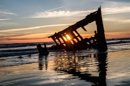 The Peter Iredale shipwreck on the beach at Fort Stevens State Park. The English sailing ship ran aground during a storm in 1906.