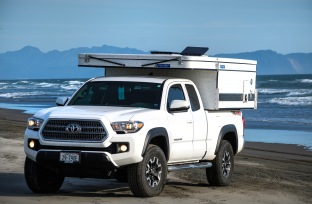 My Tacoma and Four Weel Camper on the beach at Fort Stevens, OR.