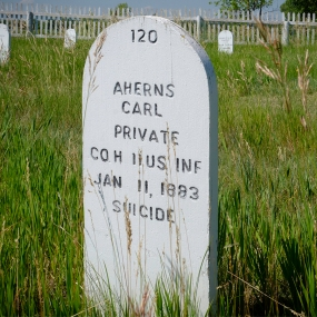 Restored grave markers in the Fort Buford cemetery include the cause of death as well as the date. Many more died from disease and affliction than bullets and arrows.