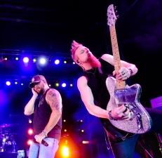 Tyler Farr with guitarist Gary Jannaman perform Friday night in the Washington County Fair arena Friday night.