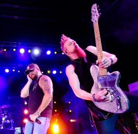 Tyler Farr with guitarist Gary Jannaman perform Friday night in the Washington County Fair arena Friday night.