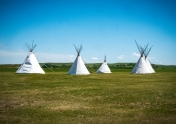 Tepees stand outside the back gate of Fort Union where Indian encampments might have been located. The back gate was the exit point to the trails and prairie beyond the fort.