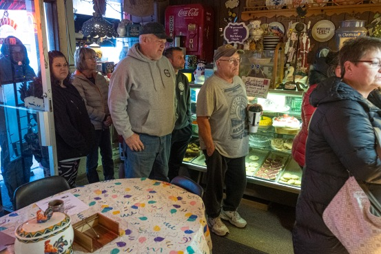 Customers wait in line