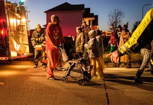 Street scene in evening light on Halloween.