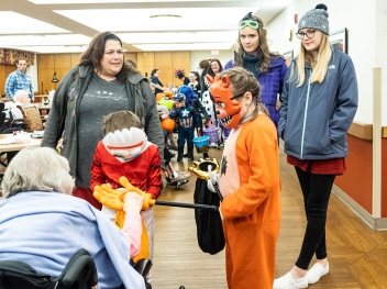 Kids getting treats ad Good Shepherd retirement