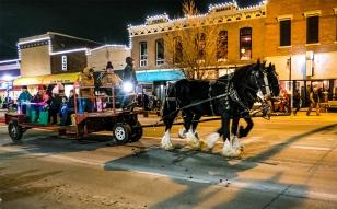 Horses and tractor pulling hayracks transported families along Washington Street.
