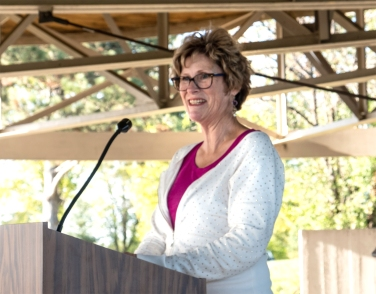 Mayda Jensen delivers remarks at the Tower of the Four Winds rededication Saturday.