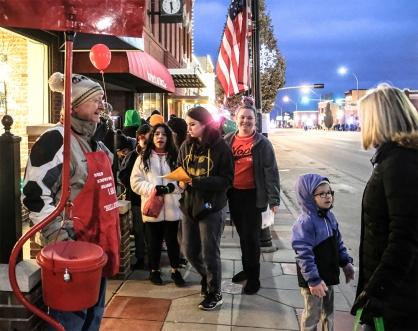 Paul Kolb greets passers-by along Washington street.