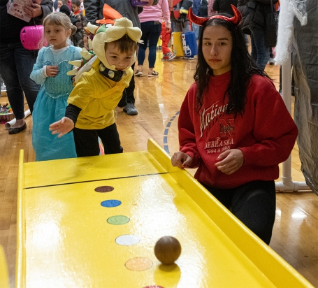 Kids in costumes playing skeeter's ball