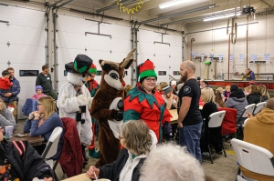 Frosty, Rudolf and elves stop by the South Fire Station for a warm up and bowl of soup.
