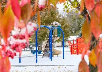 Snow coats trees and playground equipment and Stemmermann Park Wednesday morning.