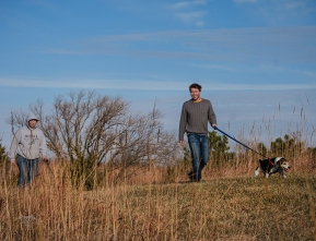 Todd and Ethan Wick walking Bailey and Skipper along the ridge trail at Black e-Neihardt Park