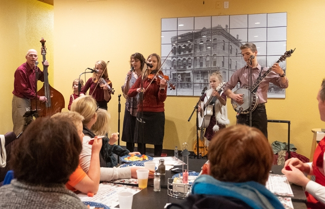 Stangl Family Singers perform Christmas music at Christmas for the Coat.
