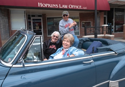 Marilyn and Greek Abariotes and Barb Sandvold watch cruise night from the comfort of the Abariotes' 1950 convertible.