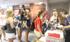 Dana students pick up packets to begin the process of applying to a new school