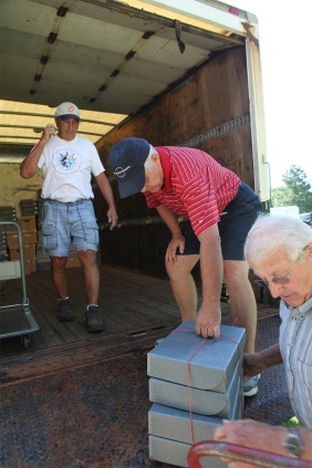 Ernie Abariotes, Bill Anderson and T. Richard Peterson load document boxes into a truck for transfer to storage at Professional Forms, Inc. in Blair.