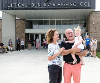Don Johnson with wife Alice and grand daughter Anna watch the parade of teachers and well wishers on Johnsons final day as Fort Calhoun school superintendent. Johnson served as Fort Calhoun as high school and middle school principal for 20 years and superintendent for 10 years.