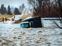 "First Place Breaking news- ""Semi swept into flood waters."