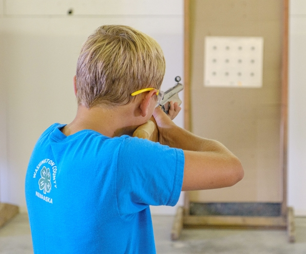 Eastan Strom competes in 4H BB gun competition.