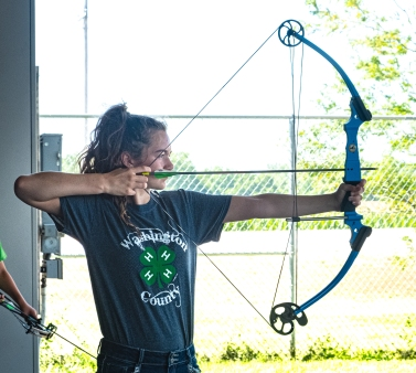 Charlzie Lambert competes in 4H Archery Competition.